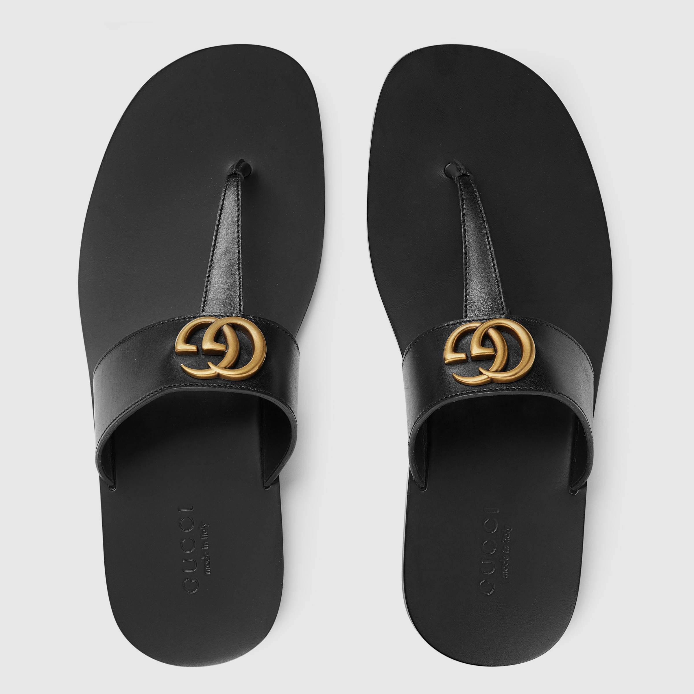 e4df4afd24 Leather thong sandal with Double G - Gucci Men's Sandals & Slides ...