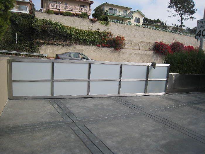 Exceptional Model: Sliding Gate, Size: 17u2032 X 3u002710u2033 Frame: Stainless Steel Glass: 1/4u201d  Laminated Obscured: White Starfire Location: Laguna Beach, CA