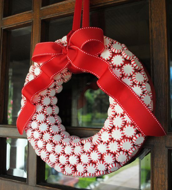 Paint craft ring red. Hot glue on pepermints. Finish it off with a bow.