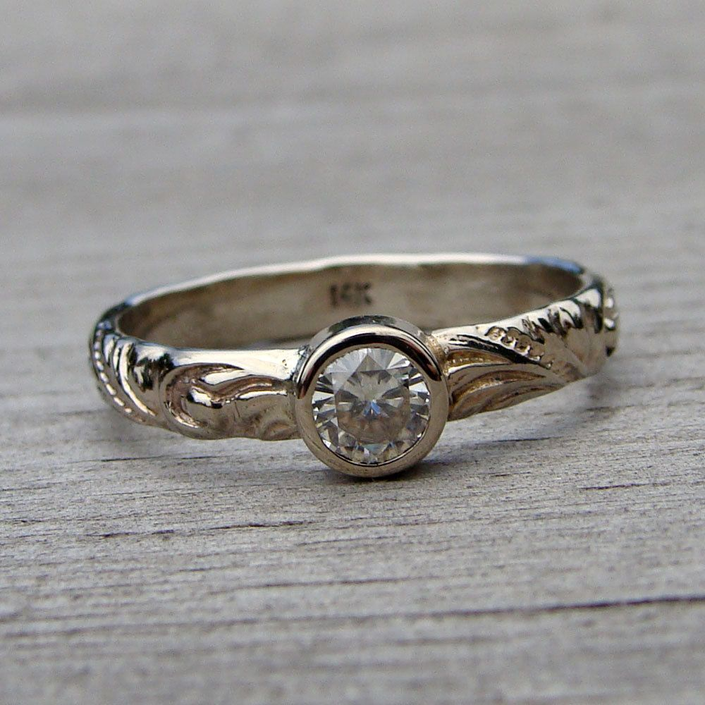 Delicate Moissanite and Recycled 14k White Gold Ring, Made To Order. $628.00, via Etsy.