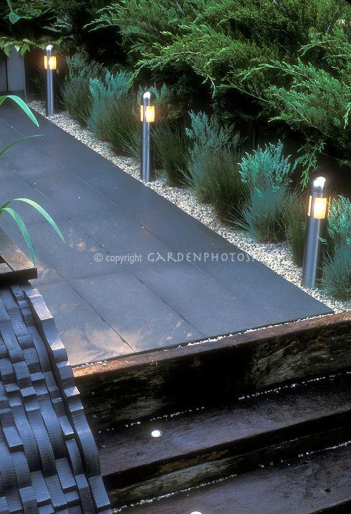 garden path lights. Built-in Step Lights And Short Pole Lighting To Illuminate Garden Path In Evening
