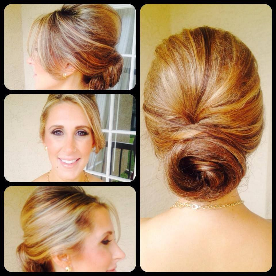 Low bun with bump and side swoop bangs perfect for weddings or