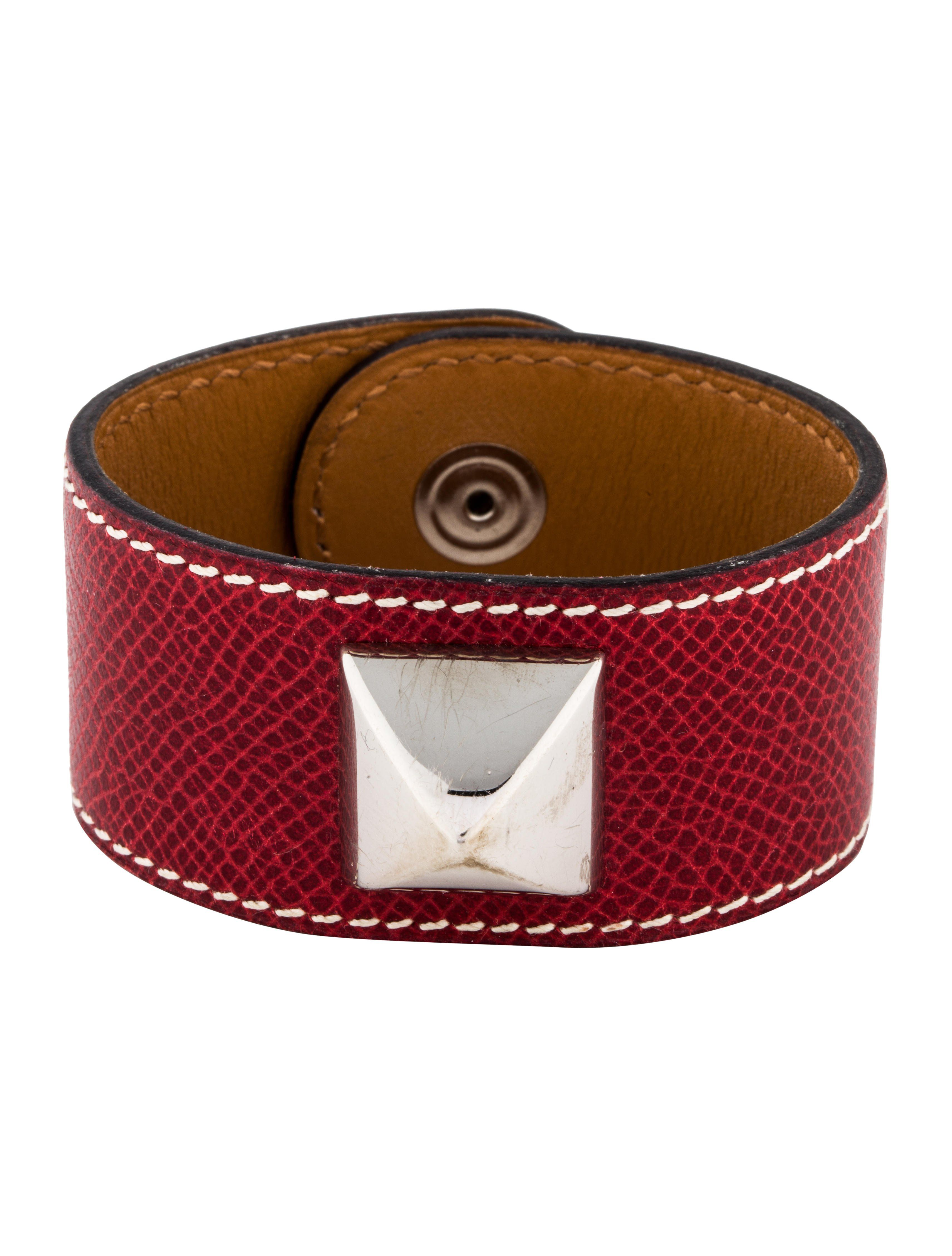 bab721e99bb Palladium-plated Hermès bracelet featuring red leather, Medor pyramid stud  at center and logo engraved snap closure.