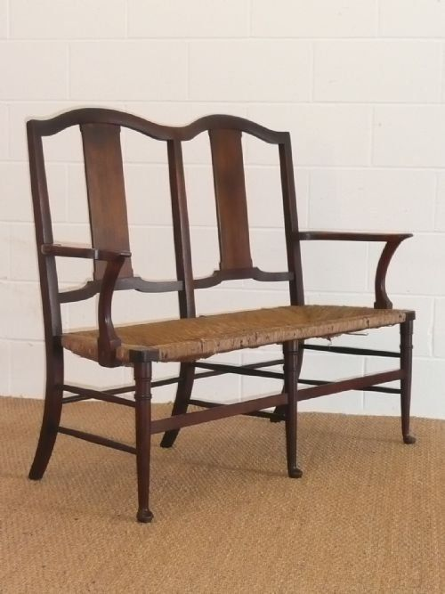 Arts & Crafts rush seated settle by William Biirch probably for Morris & Co.