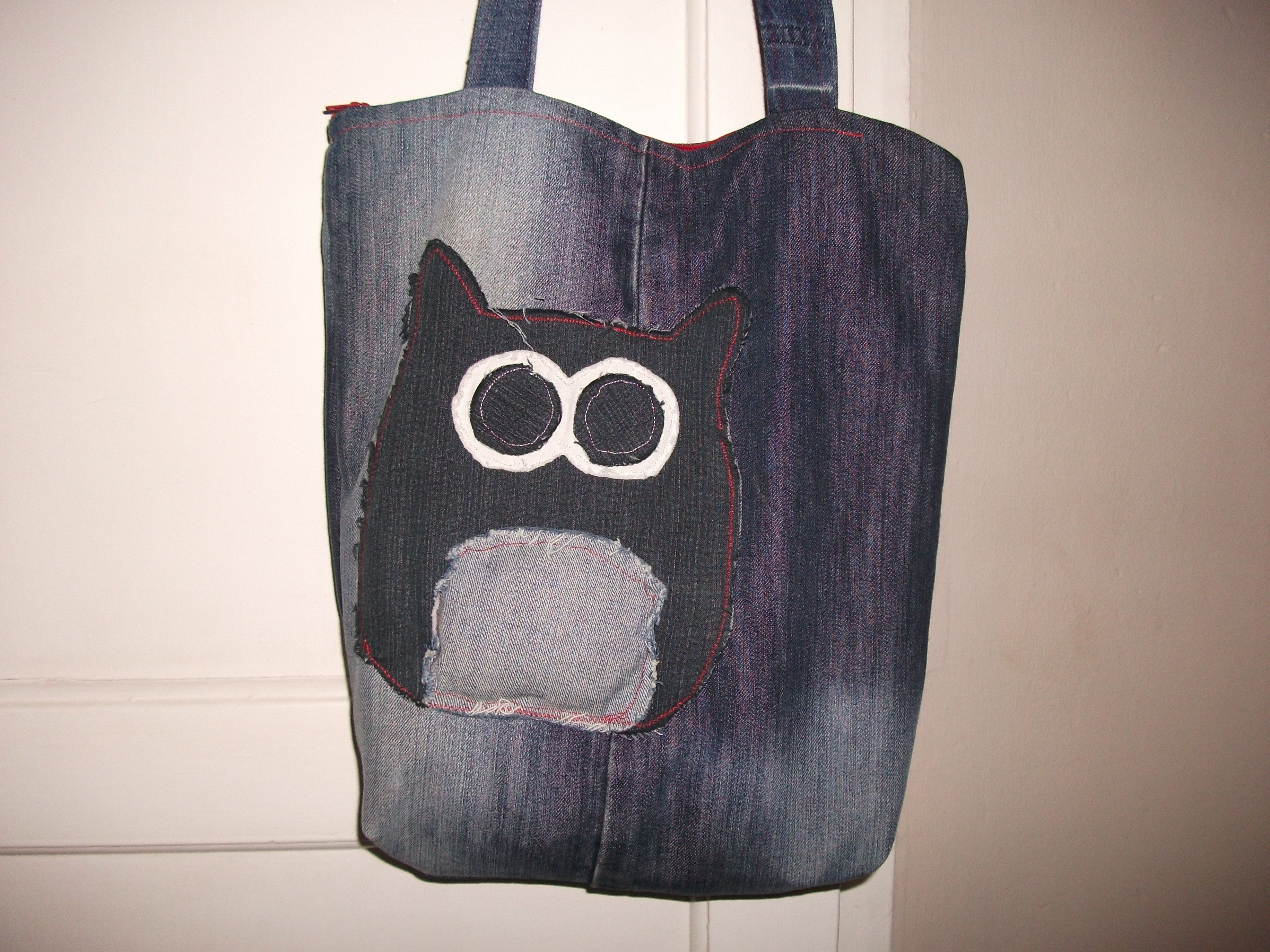 Old jeans. Owl also made using different coloured jeans and a template off the internet. This is also my first attempt at a zip fastening.