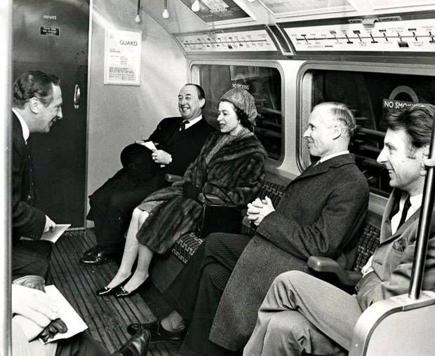 The Queen travelling on the newly opened Victoria line London Evening Standard.