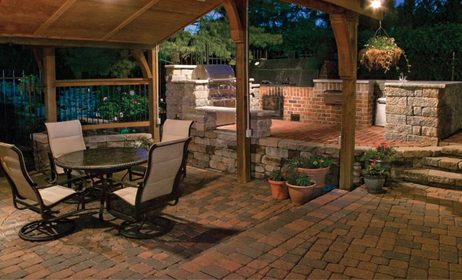 A Pavestone Plaza Stone patio with an outdoor kitchen - perfect for ...