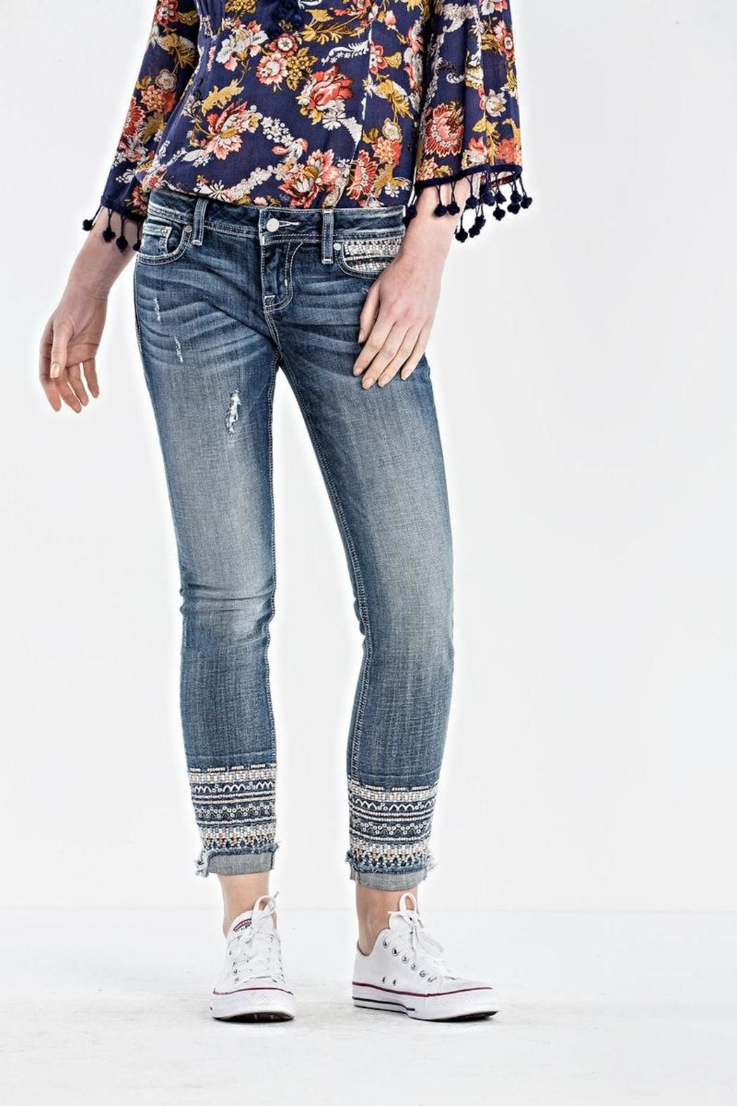 aa5aeac7a2ce95 Flaunt your bohemian style in a pair of ankle skinny jeans with embroidery  around the bottom