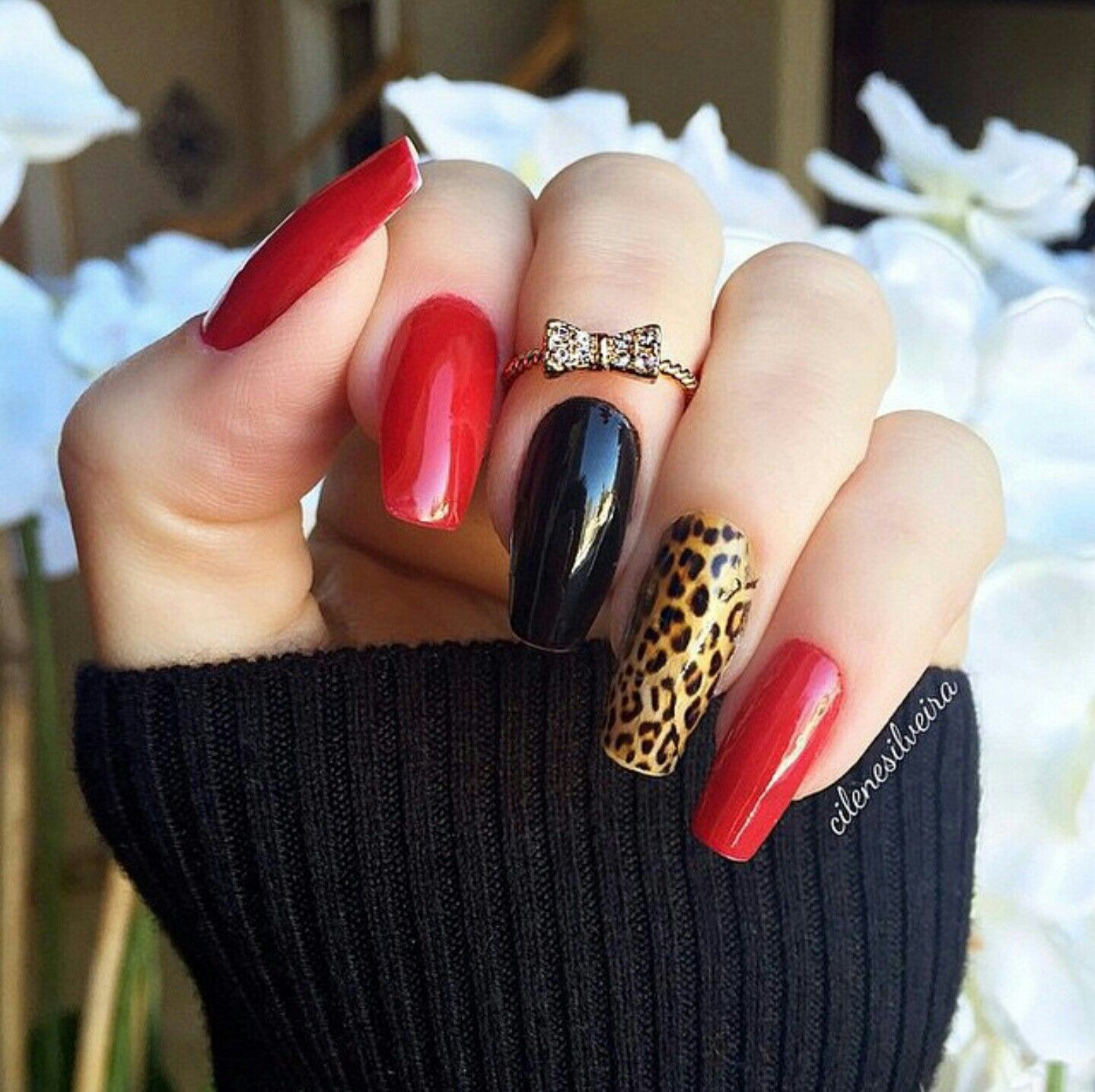 Photo of Red & black nails, leopard print nail art accent