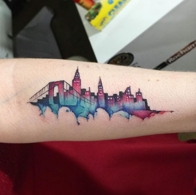 100 Watercolor Tattoos That Perfectly Replicate The Medium: NYC Watercolor Skyline By June Jung