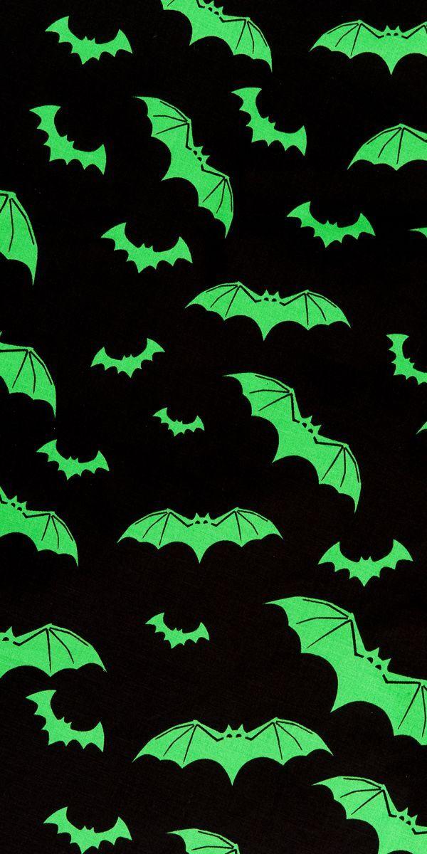 green bats black background halloween wallpaper