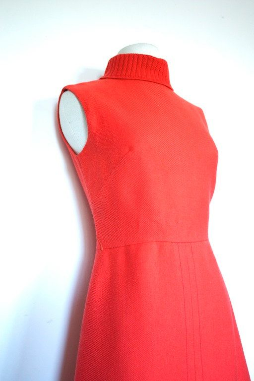 Great Fall/Winter Mad men style day dress! it is a lovely orange wool. It is fitted with a slightly A-line skirt. It is sleeveless with a wonderful cozy turtle neck. Would look great with tights and a cardigan for the Fall!