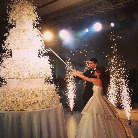 Talk about over the top! That wedding cake is ridiculously massive!!!