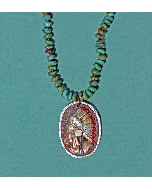 """<p class=""""MsoNormal""""><span style=""""font-size:12.0pt;line-height:115%;font-family: """"Times New Roman"""",""""serif"""""""">Turquoise rondelle beads are hand strung and knotted on silk cord and embellished with large hand forged pewter oval, deer leather and antique reproduction Indian Head that has been hand painted. Necklace is 18 – 20"""" and has an extender chain.<o:p></o:p></span></p>"""