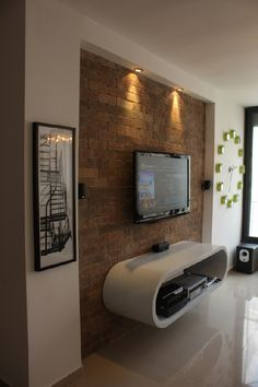 slightly inset stone or brick wall section for tv more traditional media console beneath - Media Wall Design