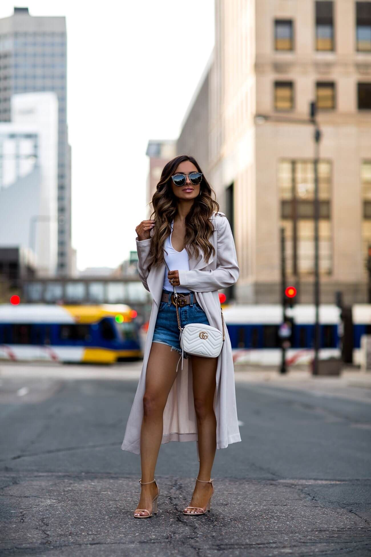 dc3d38b313 Basics To Take You Into Summer - fashion blogger mia mia mine wearing a  nude trench coat and cut-off denim shorts