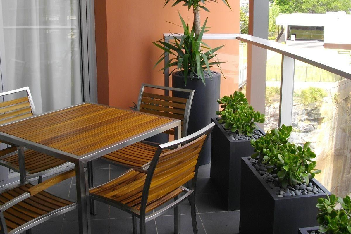 Narrow Planters And Compact Furniture Make Maximum Use Of A Small Balcony