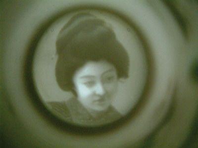 Cup geisha girl in bottom