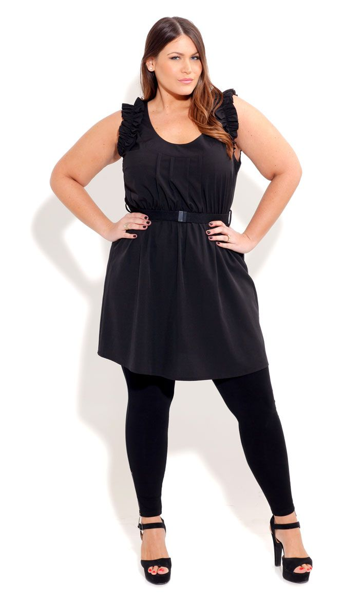 Plus size fashion, ruffled shoulder dress.