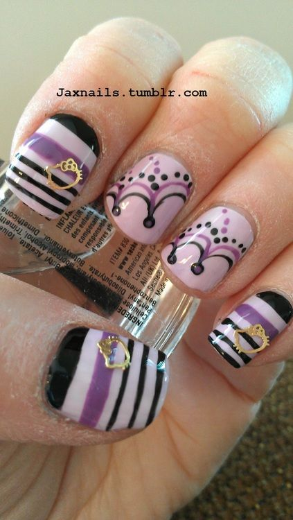Purples, blacks in design with thin gold nail jewelry glued down for ...