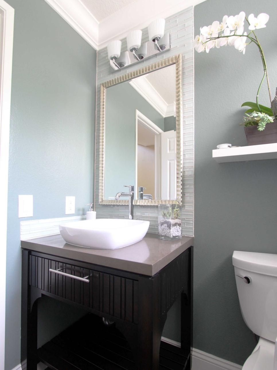 In this soothing blue-gray and white contemporary bathroom, small ...
