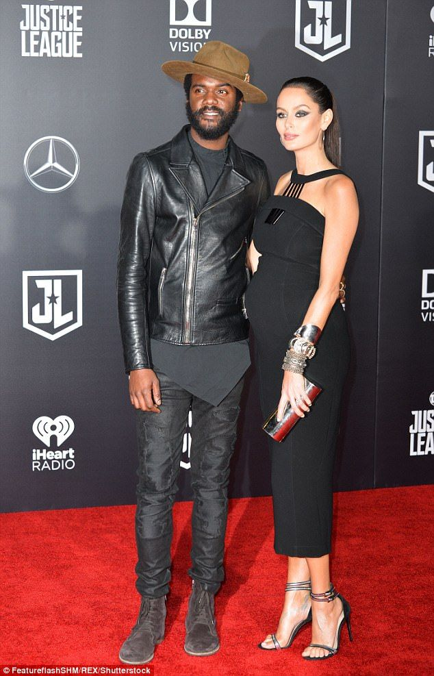 Things that go bump in the night! Pregnant Nicole Trunfio shows off her stunning pregnancy figure as she attends evening movie premiere with her beau Gary Clark Jr.
