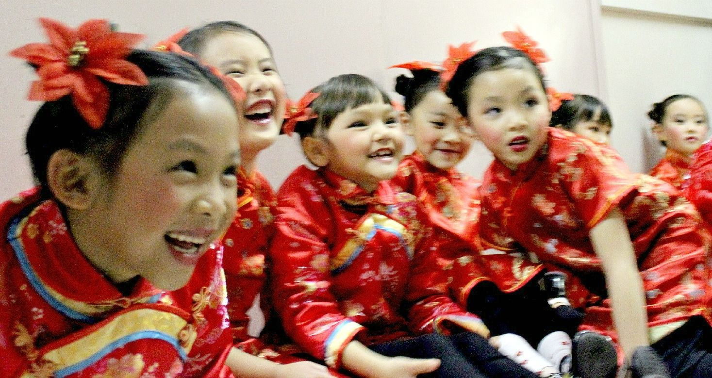 Traditional Chinese Children's Hairstyle: Two Buns on the Sides ...