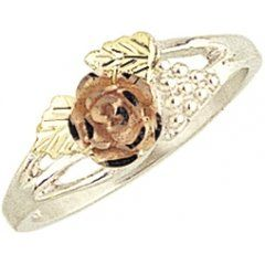 This is one of the prettiest Black Hills Gold rose bud rings in all that are made.The body of the ring is Sterling-Silver and the Leaves are lime gold to set off the Pink diamond cut Rose. It has a diamond cut rose for real sparkle. No picture could do it justice. Lifetime warranty from the manufacture