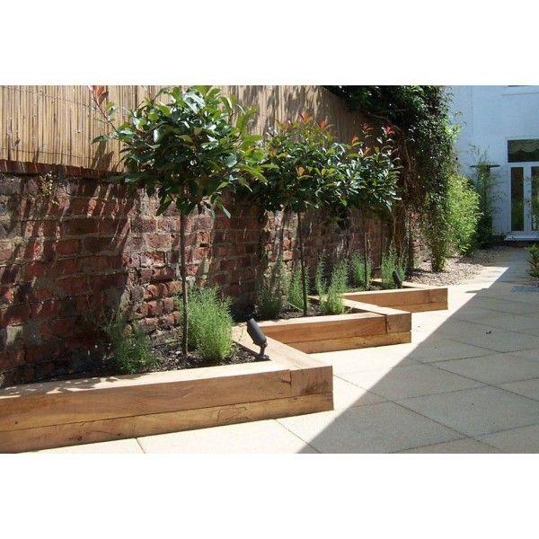 Railway sleepers garden borders google search garden for Garden design railway sleepers