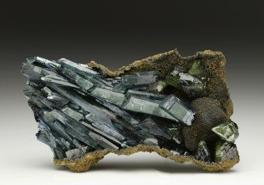 Vivianite, Fe3(PO4)2•8(H2O), crystals, with green Ludlamite crystals, Brazil. Group of parallel development well-formed deep blue-and-green. Size 7.8 x 4.5cm