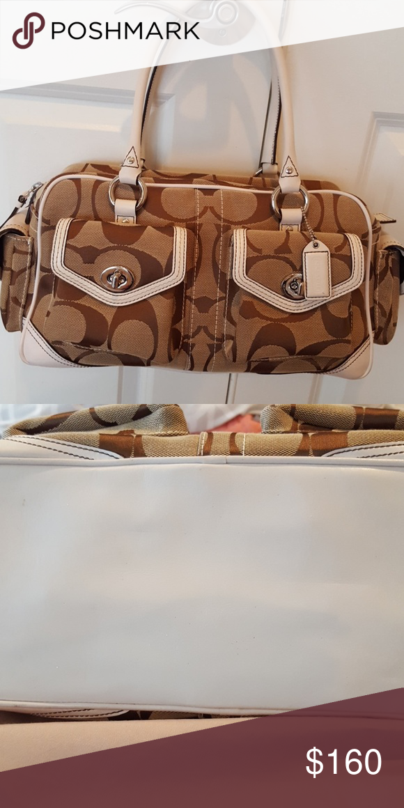 Coach handbag Like new condition authentic Coach satchel style bag.  Bottom of purse is white leather and in great shape. Coach Bags