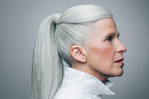 silver grey hair. white ponytail