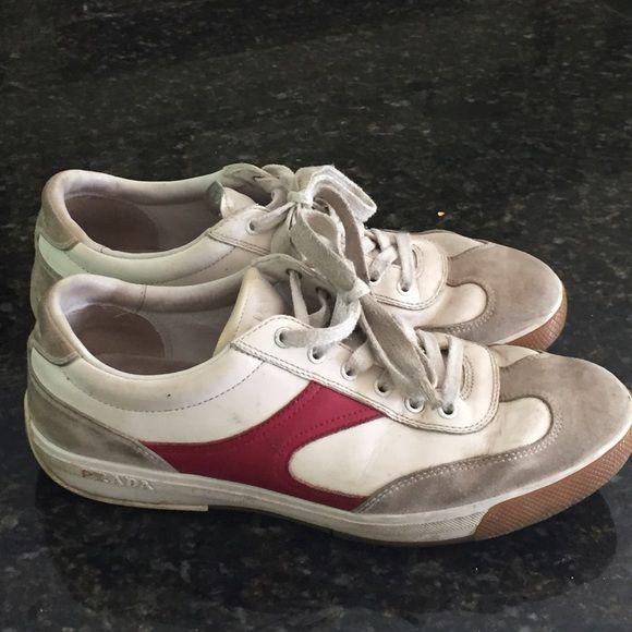 Men's Prada Sneakers. My husbands Red and white authentic Prada sneakers. Good condition Prada Shoes Sneakers