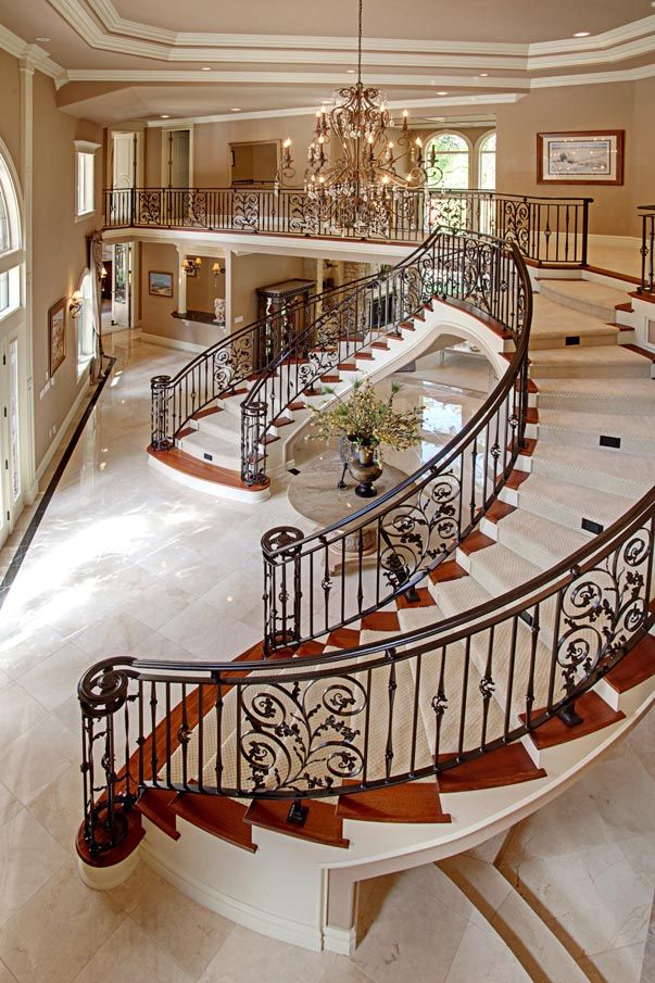 luxurious and splendid elegant stairs design. A staircase framed with wood edging and crafted iron railings  this beautiful entrance hall sings of luxury homes design living 40 Luxurious Grand Foyers For Your Elegant Home Luxury