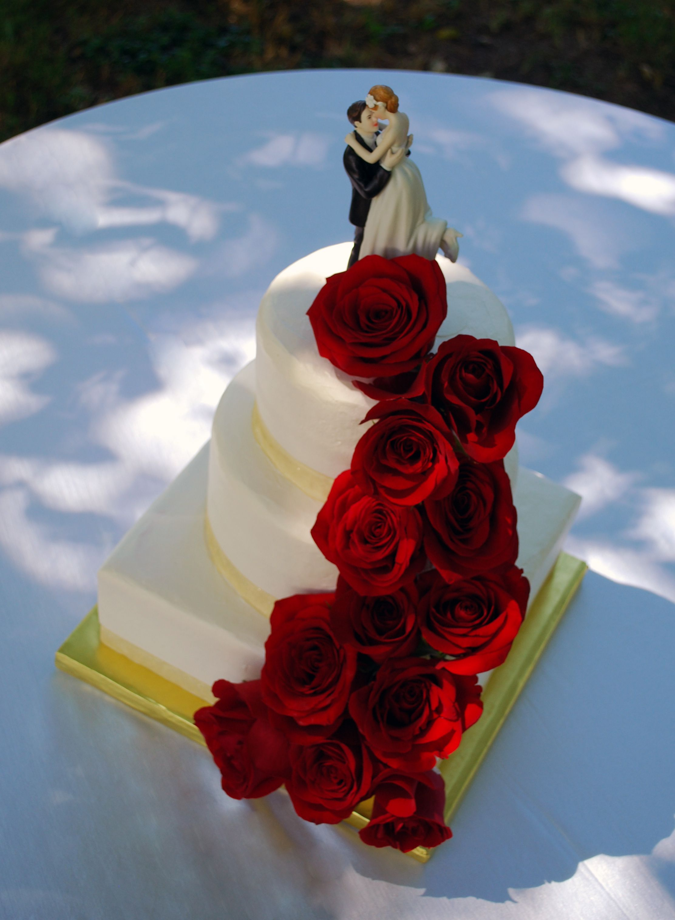 Round and Square Wedding Cake with Cascading Red Roses... toptierweddingcakes.dotphoto.com