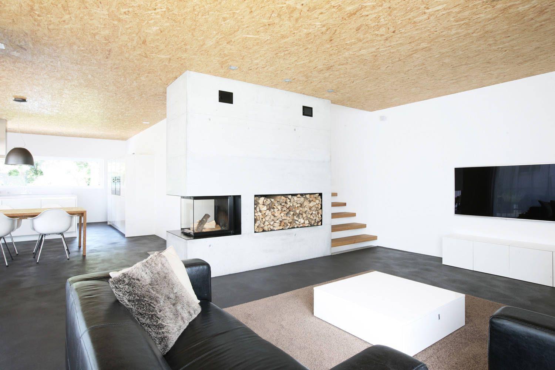 Modernes bungalow innenarchitektur wohnzimmer efh kirchberg moderne wohnzimmer von skizzenrolle  haus