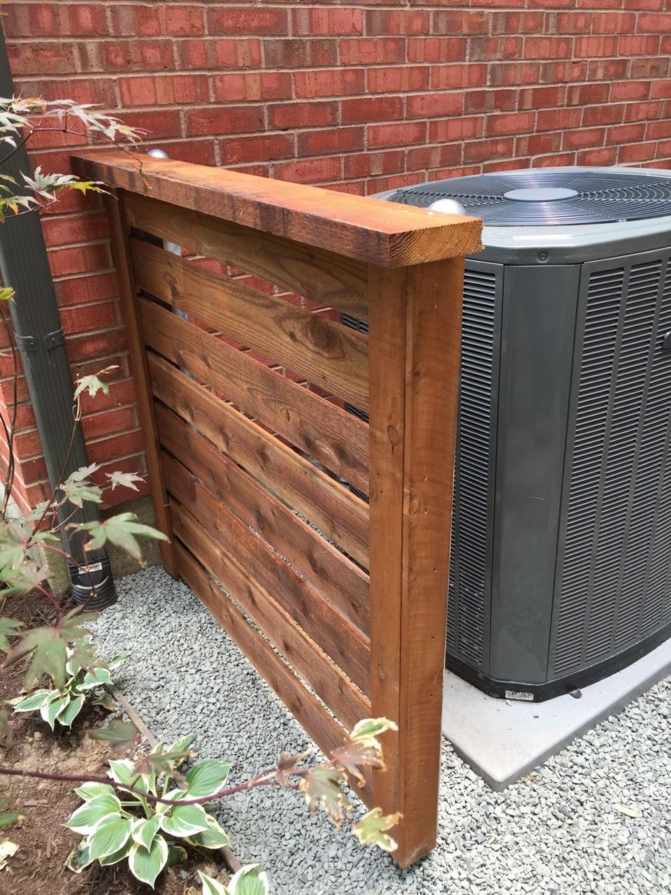 Cedar a/c cover on metal posts. installed by Titan Fence