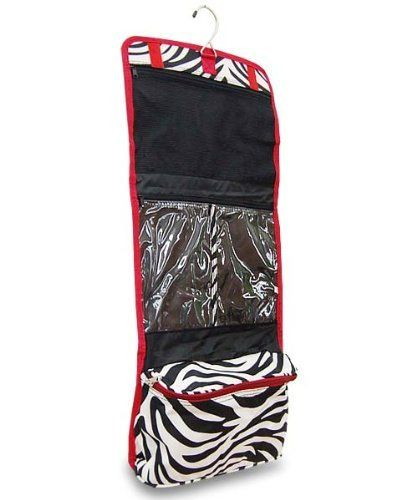 """Women's Hanging Travel Cosmetic - Makeup Bag - Zebra Print with Red Trim by Treasures & Treasures. $14.25. 1 large mess zippered compartment. 2 clear zippered compartments. 11.5 """"L X """"D X 26 """"H. Large zippered make up bag at bottom. Adorable Zebra Print with Hot Pink Trim Hanging Travel Cosmetic Bag. Has a large top mess compartment, a large divided clear compartment and a large makeup bag at the bottom. Provides ample space for your cosmetics and travel shower items. A..."""