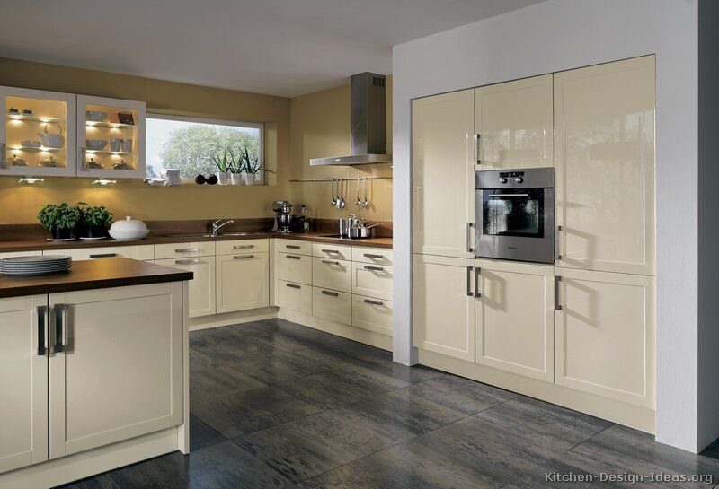 Kitchen idea of the day modern cream colored kitchen by for Cream kitchen cupboards
