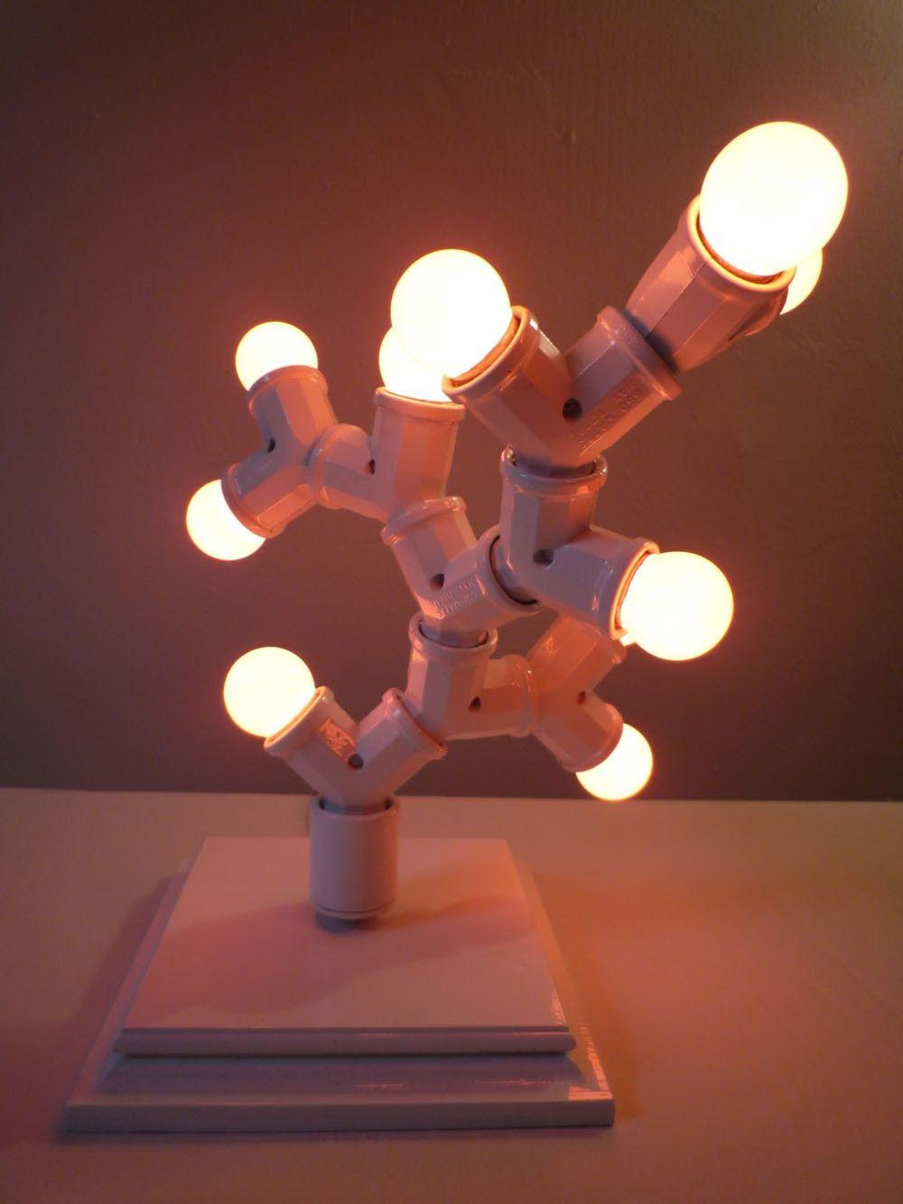 Sophisticated table light (white w/ orange bulbs). $218.00, via Etsy.
