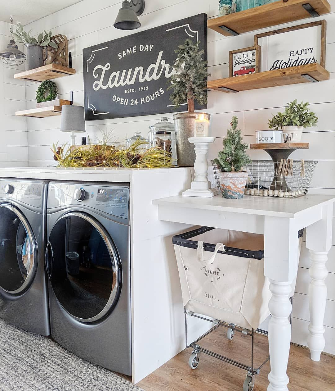 Farmhouse style laundry room with shiplap walls, open wood