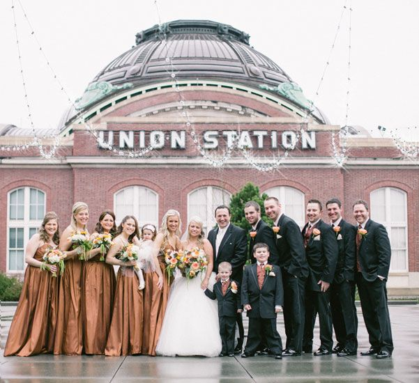Bridal Party In Beatiful Floor Length Bronze Gowns And Their Groomsmen Against Union Station Tacoma WA The Rain Will Not Keep Away This Happy Bunch