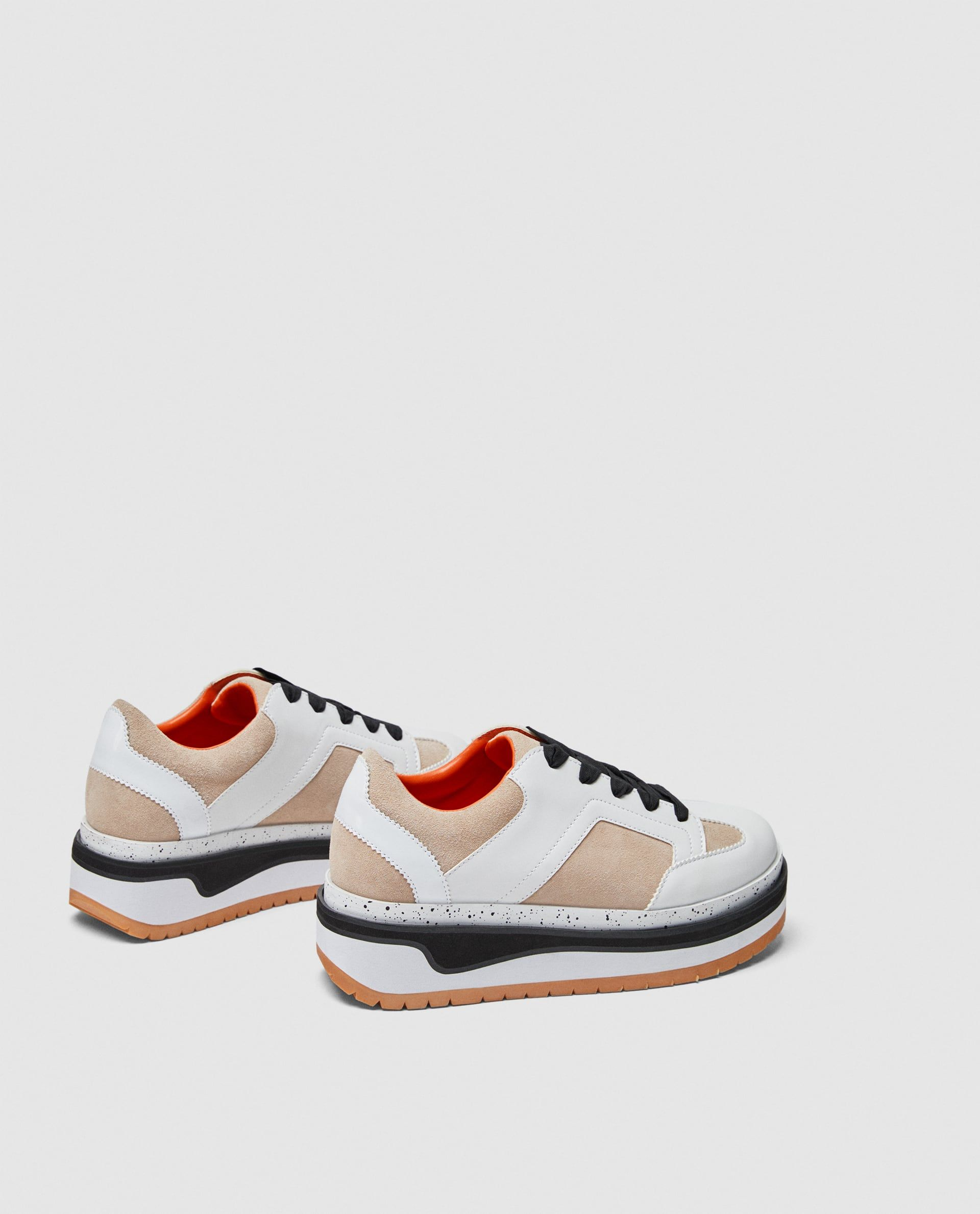 bbca3d33694be9 Image 1 of CONTRASTING FLATFORM SNEAKERS from Zara