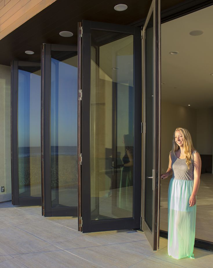 9ft Tall Glass Bifold Doors Open The Entire Wall To The Beach Outside Oversized Doors Glass Bifold Doors Bifold Doors Folding Glass Doors