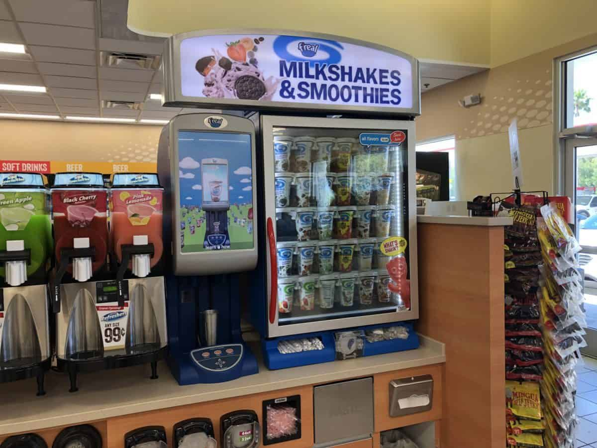 Photos Magic Kingdom Speedway Gas Station Reopens Wdw News Today The F Real Milkshakes And Smoothies Machin Speedway Gas Station Gas Station Petrol Station