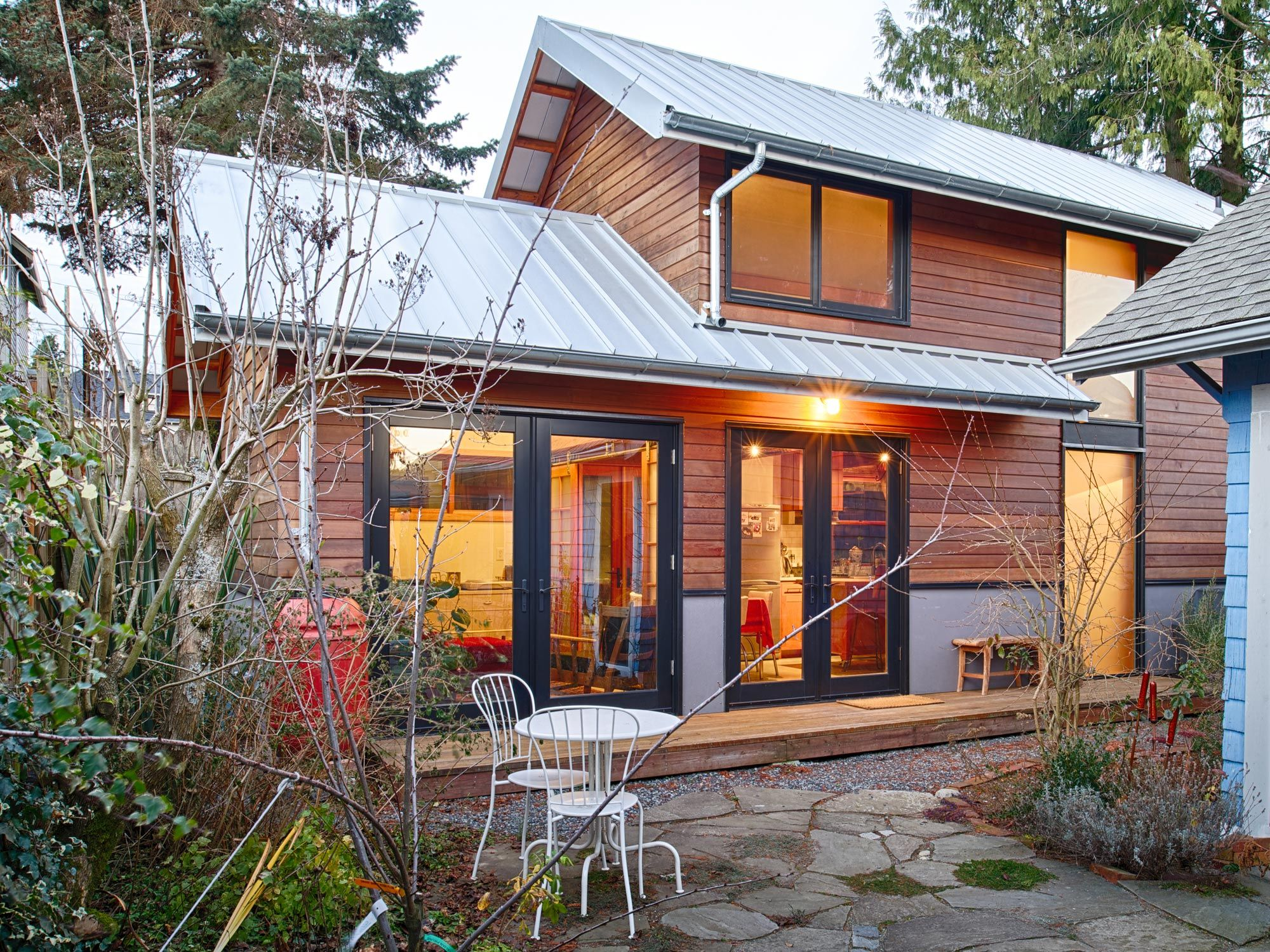 A rustic backyard art studio and guest house constructed ...