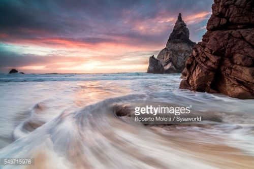 The fiery sky at sunset is reflected on the ocean waves and... #colares: The fiery sky at sunset is reflected on the ocean waves… #colares