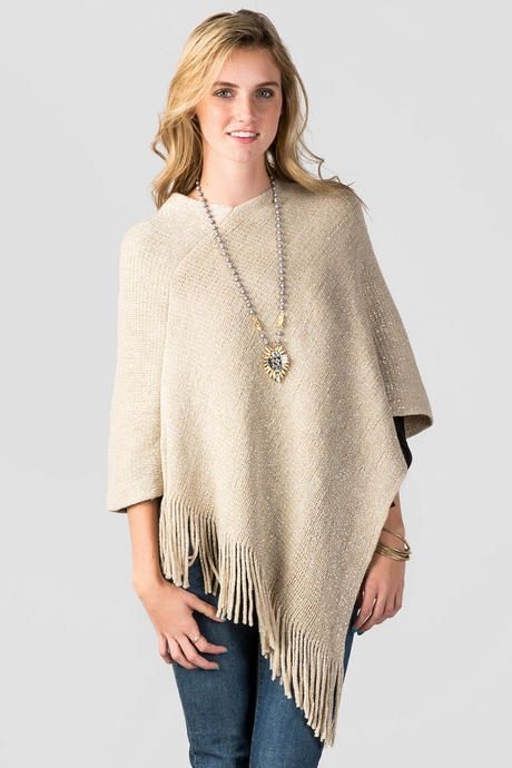 """Stay warm and fashionable this season with the McKenna Lurex Fringe Poncho! Lurex is woven throughout this poncho, adding a subtle shine. Wear it wear jeans and ankle boots forthe perfect outfit!<br />  <br />  - 35"""" length from shoulder to hem<br />  - One size fits all<br />  - 100% Acrylic<br />  - Dry clean only<br />  - Imported"""