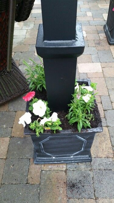 We used planters filled with rocks, soil and flowers to ...