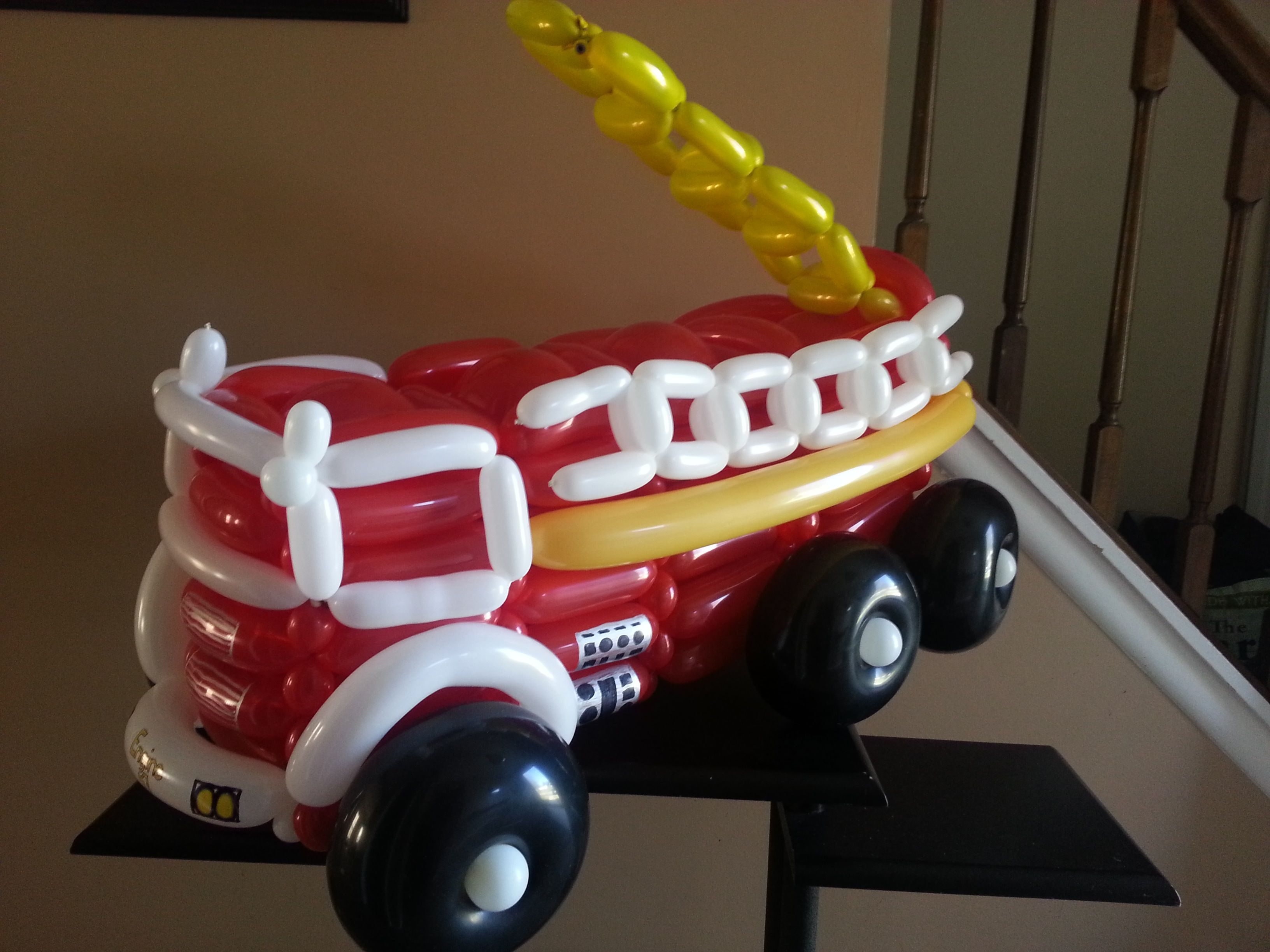 Fire truck balloon sculpture by tru b loons decorations